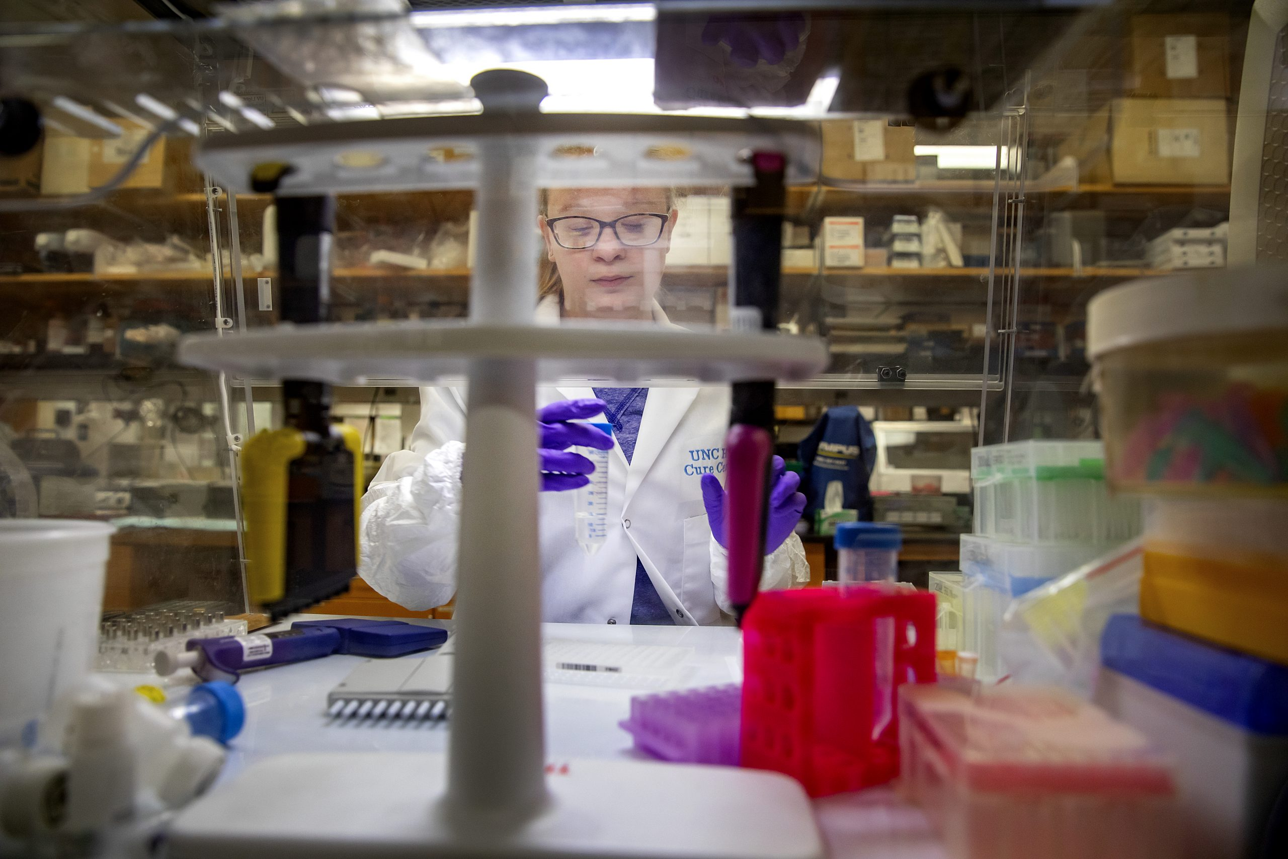 woman works with test tubes in lab