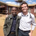two friends pose in Malawi