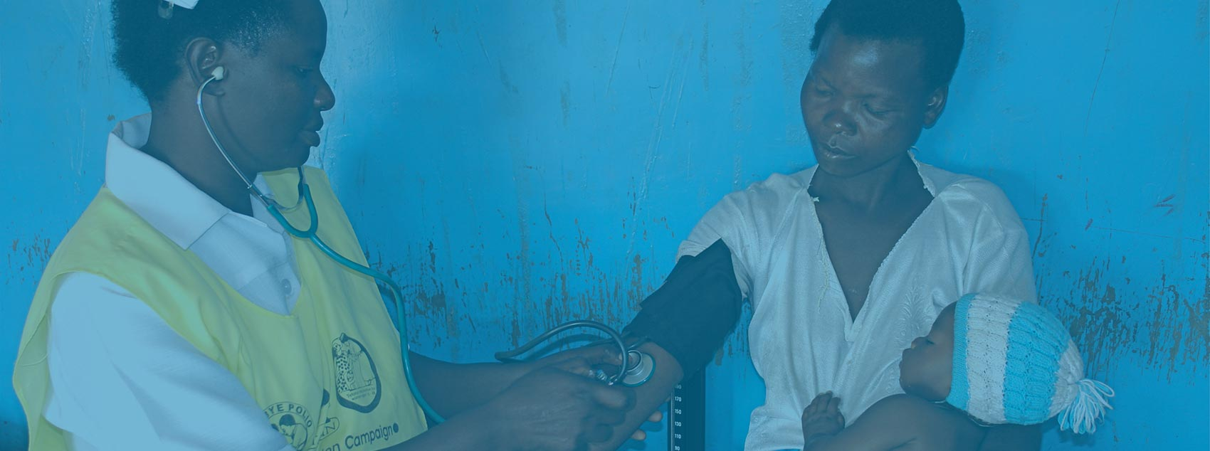 Zambian nurse takes mother's blood pressure