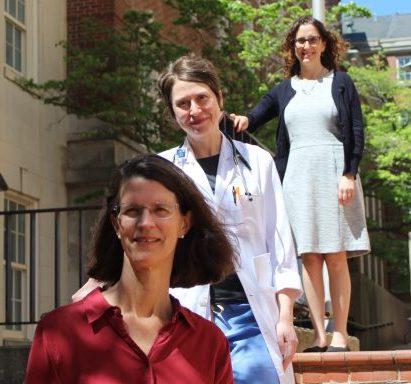 three doctors on steps