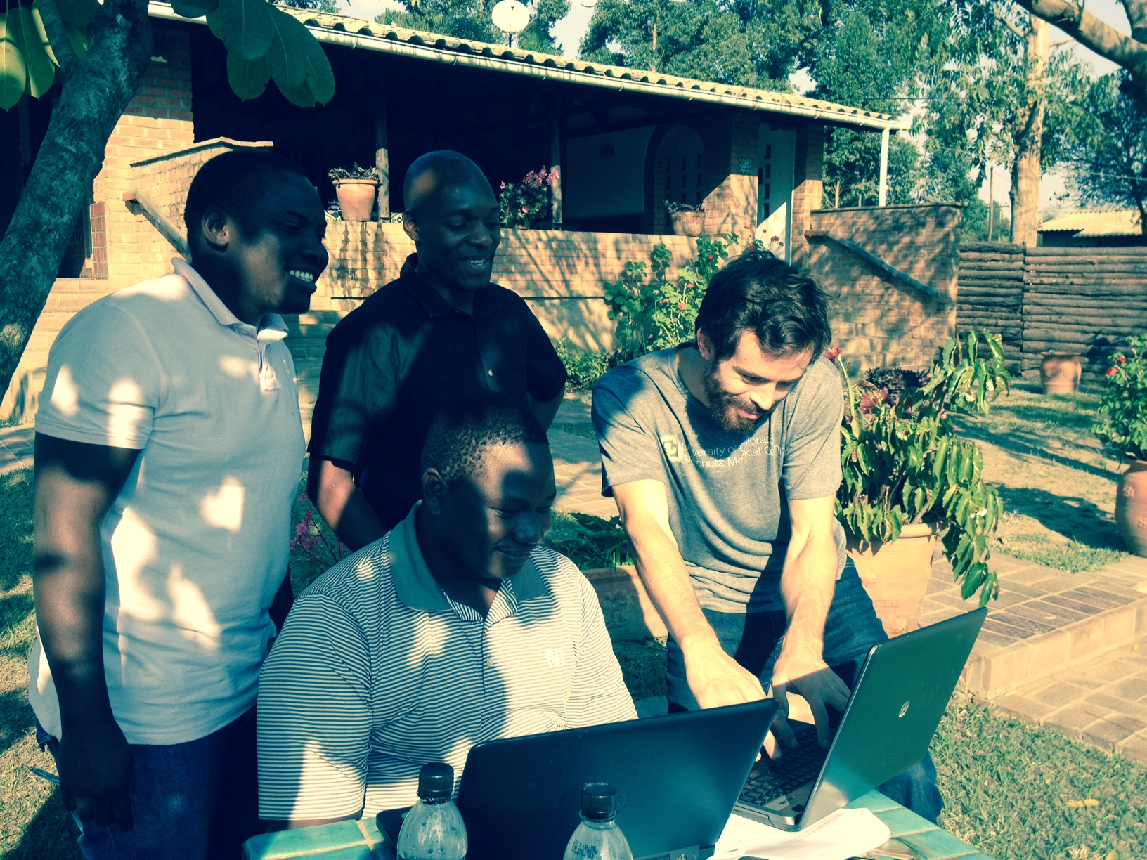 Trainee working with colleagues in Uganda