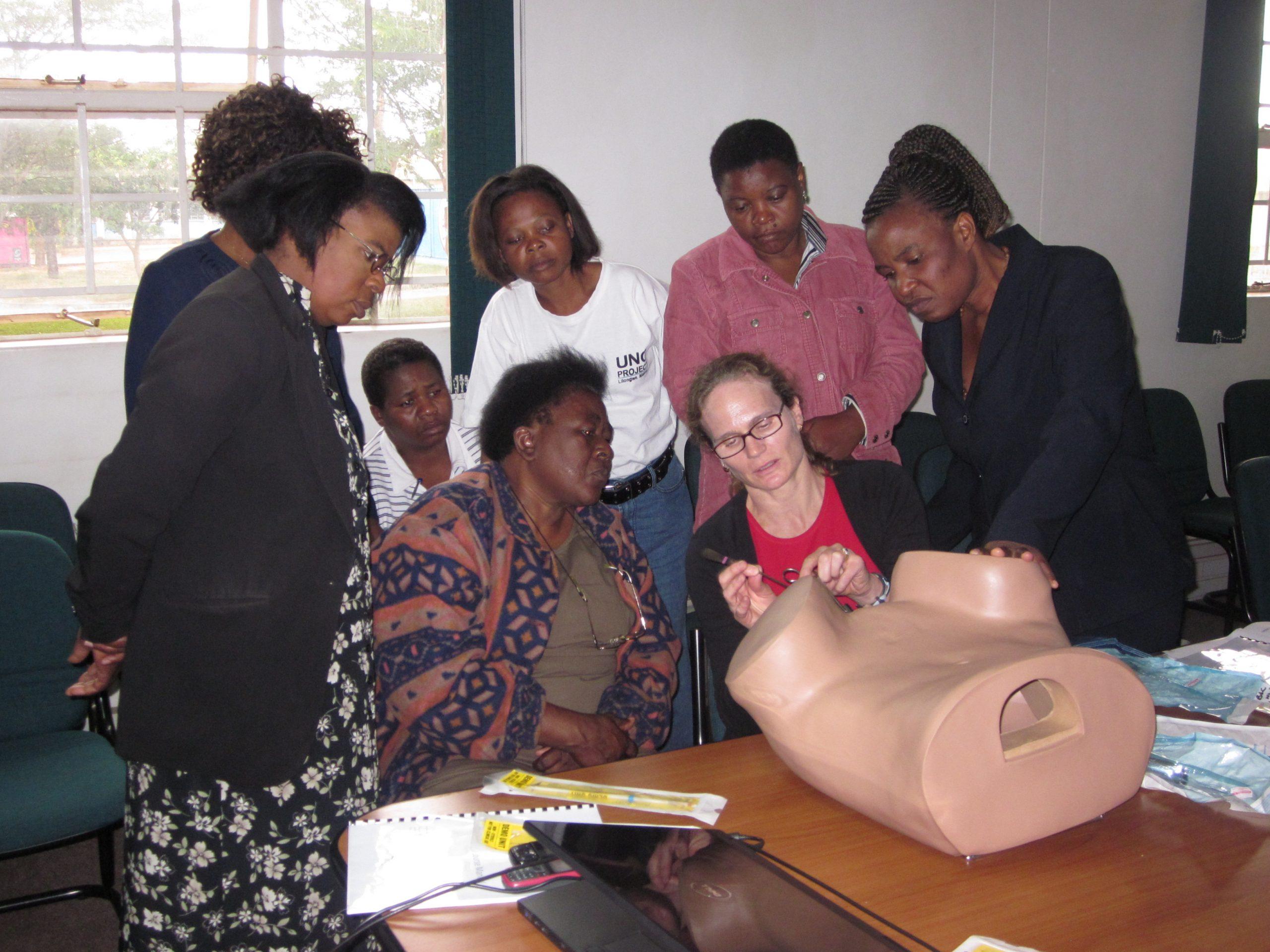 Gretchen Stuart (UNC) trains Malawian nurses on the proper method to insert an IUCD, UNC Project-Malawi