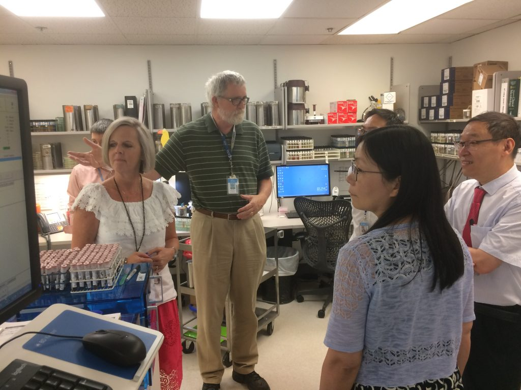 UNC Project China trainees learn about UNC Lab systems