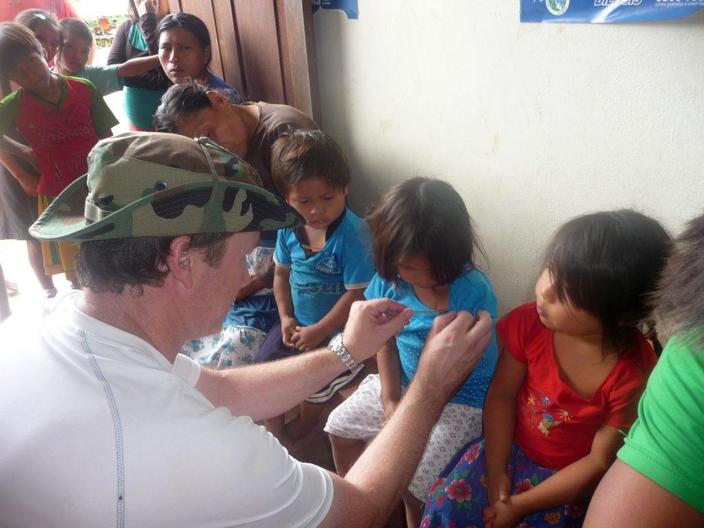 UJMT Trainee Michael Deshotel working with children in Peru